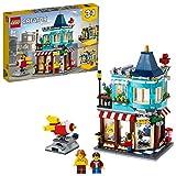 LEGO 31105 Creator 3in1 Le magasin de jouets du centre-ville- Pâtisserie - Fleuriste Ensemble de construction, avec fusée fonctionnelle
