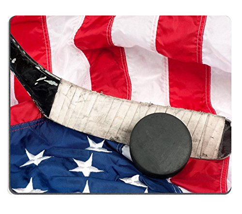 Luxlady Gaming Mousepad Hockey Equipment Including a Stick and Puck on an American Flag to infer a Patriotic American Sport Image ID 7909525