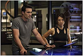 Agents of S.H.I.E.L.D. (8 inch by 10 inch) PHOTOGRAPH Brett Dalton in Grey Tee Shirt Next to Ming-Na Wen in Sexy Cutout Out Sleeveless Top at Table Pose 1 kn