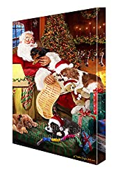 King Charles Cavalier Spaniel Dog and Puppies Sleeping With Santaキャンバスギャラリーラップ1.5