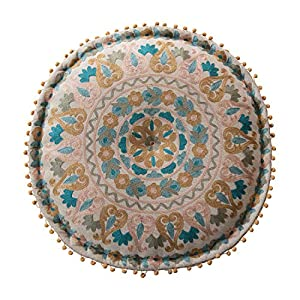 "Cotton pouf is embroidered Pouf is cream with pink, blue, and marigold details Pattern illustrates a symmetrical, circular design Round pouf also has pom-poms 24"" Round x 8""H"