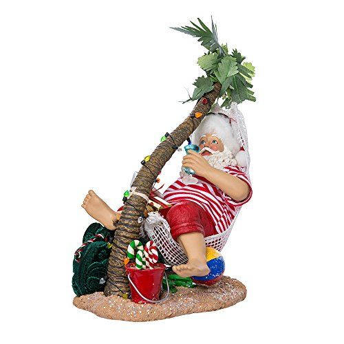 Kurt Adler 10-Inch Fabriché Beach Santa on Hammock Under Palm Tree