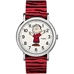 Adjustable red & black striped 20mm fabric slip-thru strap fits up to 7.5-inch wrist circumference White dial with full Arabic numerals featuring Linus Silver-tone 38mm brass case with mineral glass crystal Indiglo light-up watch dial Water resistant...