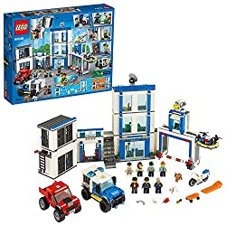 Features 4-sections, two storeys police headquarters station with jailbreak explosion function, two truck toys, a motorcycle and a drone toy Includes a light-brick searchlight, working roof lights and siren, plus lever-activated jailbreak function to...