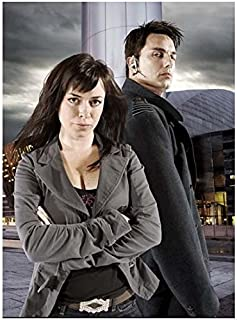 Torchwood John Barrowman is Captain Jack with Eve Myles as Gwen Cooper Arms Crossed 8 x 10 Photo