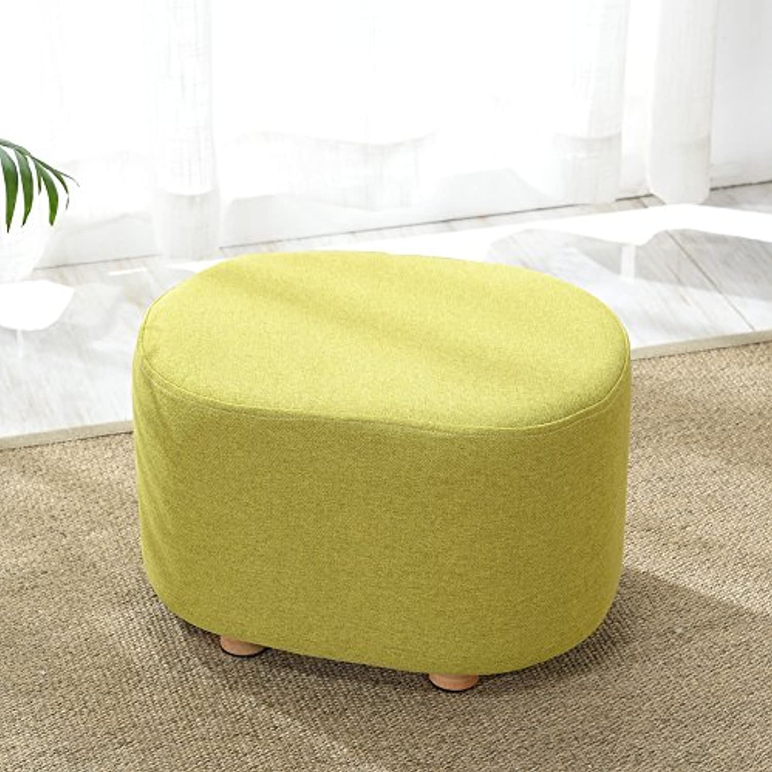 Dana Carrie Sitting on a low stool stool for shoes and the implementation of the sofa chair fabrics solid wood in a minimalist modern living room ideas a small round, Green