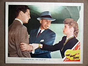 DV44 Two Smart People LUCILLE BALL 1946 Lobby Card.  Here's a terrific lobby card from the original release of TWO SMART PEOPLE featuring a great image of LUCILLE BALL and JOHN HODIAK.    Lobby card is in EXCELLENT- condition. No pinholes, no stains, a one-half inch edge tear on the bottom border.
