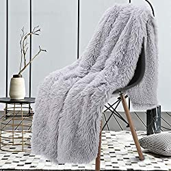 blanket made out of faux fur thrown over a chair