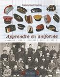 Apprendre en uniforme: Vêtements officiels, insignes et attributs symboliques portés par...