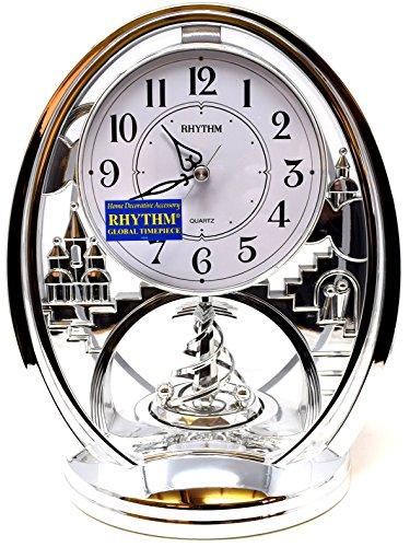 Rhythm Cont Mantel Clk Oval Silver/Arabic Dial/Rotating Pend by Rhythm
