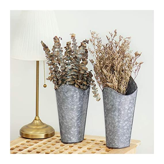 Mkono Galvanized Metal Wall Planter, 2 Sets Farmhouse Style Hanging Wall Vase Planters for Succulents or Herbs,Wall Planters for Rustic Home Wall Decor 6 This is a unique set of two galvanized metal wall planters,match succulents or any artificial greenery. Adds rustic and country sense for household style, ideal for home decoration to display plants. Helps to beautify and purify your house, perfect addition for livingroom, bedroom, bathroom, dining room, kitchen and any occasion. Galvanized Metal Wall Plant Container features an antique finish which can be hung on the wall above headboard with a picture or clock in between to display for the world to see, but also can use on the desk. This gorgeous piece is perfect for holding faux flowers,fake lavender,eucalyptus plants, cotton stems and other decorative pieces. Hanging wall vase planters is easy to install.Comes with all necessary hardware,Just hang on the wall directly. Package included 2 set metal planters and 3 seamless nails. Perfect decorations gift for birthday, anniversary, holidays, Mother,s Day, Fater,s Day ,Wedding,and any other occasion.