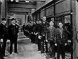 A Film still of Charlie Chaplin in a Jail Photo Print (25,40 x 20,32 cm)