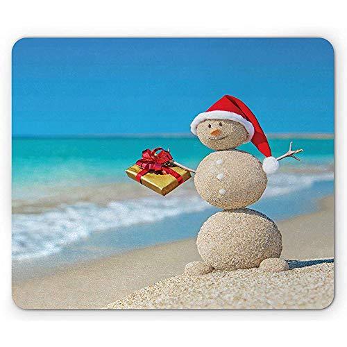 Kerstmis mat, zand sneeuwpop met sankt-hoed en aanwezige tropische strand-Australië Noel, blauw en zinnoberrood