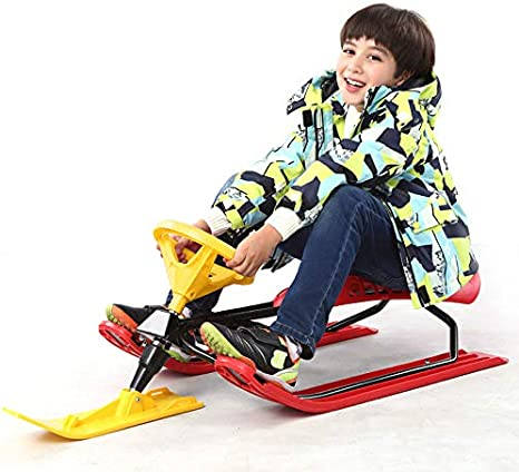 Red plastic snow sledge sled.Childs sled with handle breaks//steering