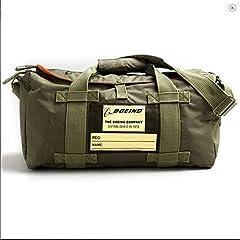 Khaki nylon exterior, orange interior YKK brass zippers 17″ l x 9″ h x 8″ w