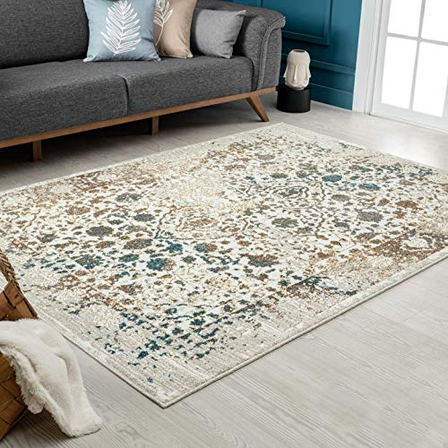 Cream rug with distressed persian pattern