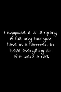 I suppose it is tempting, if the only tool you have is a hammer, to treat everything as if it were a nail.: Lined Notebook with funny sarcastic office quotes.