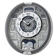 Rotating center dial opens and closes when melodies are played. Features ornaments of Swarovski Crystals. On the hour, the clock plays one of 18 melodies with motion Three sets of melodies are available for selection on the control panel:The Four Sea...