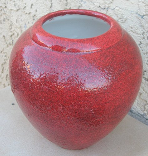 Handmade round burnt orange vase or seed pot. Made by Native artisan