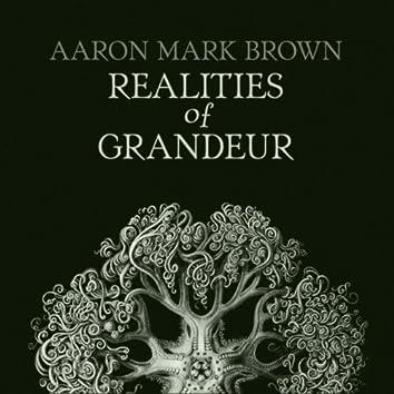 Realities of Grandeur