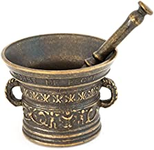 Reproducción de un mortero antiguo con mano de mortero de bronce de farmacéutico