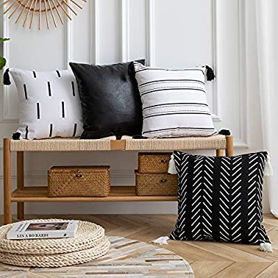 DEZENE Couch Throw Pillow Covers: Set of 4 18x18 Inch 100% Cotton and Faux Leather Decorative Pillow Cases with Tassels for Bedroom Living Room Sofa, White and Black