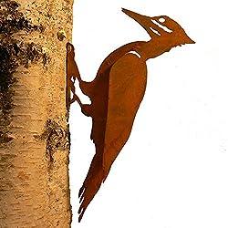 Garden art woodpecker on tree.