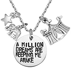 "Inspired by the popular, award-winning musical, this necklace features the lyrics ""A Million Dreams Are Keeping Me Awake"" disc with charms of a circus tent, an elephant and a star. Hangs on an stainless steel chain. The Perfect Gift for a Circus Them..."