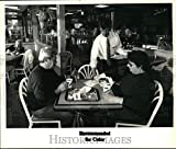Historic Images - Press Photo Manager Delivers Food to Table at Burger King in New York
