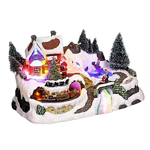 Pueblo de Navidad luminoso con tren