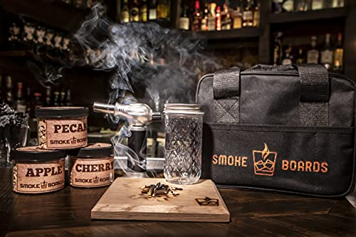 Smoked Cocktail Kit. The only complete 7 Piece Home Bartender Kit with carrying case and torch included! Handcrafted White Oak Smoking Board with 3 different wood chips including mason jar and case.