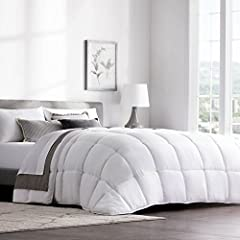 Hotel-style Classic White comforter is hypoallergenic and perfect for all seasons. Material is polyester 300 GSM, mid-weight design with box stitching prevents shifting or clumping for Premium comfort 8 Sewn-in corner and side tabs keep your favorite...