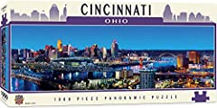 Cincinnati skyline puzzle Made in USA - 1000 pieces in finished 13 inch x 39 inch panoramic puzzle MasterPieces - An American Puzzle & Game Company. We stand behind our products and guarantee your satisfaction Thick puzzle board ensures a tight inter...