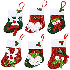 """YOU GET a set of 6 adorable mini Christmas stockings 4""""W x 7""""H. Your stocking pack includes six adorable 3D stockings: santa, snowman & reindeer each on a red and a green small stocking. BE PREPARED! Order a set today so you have a gift ready for tha..."""
