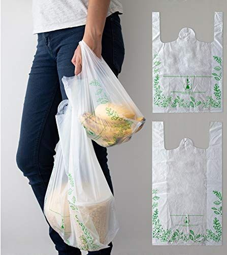 Paquete 100 bolsas grandes certificadas compostables tipo camiseta (31 cm de frente x 38 cm de alto sin asa y de 58 cm de alto con asa. Fuelle de 10 cm). Producto de fécula de maíz biodegradable en menos de un año