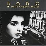 Passing Stranger - Bobo in White Wooden Houses
