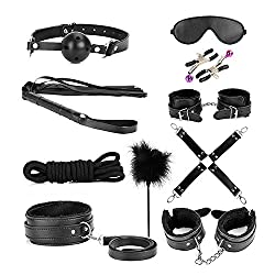 Bondage set with handcuffs, whip, rope etc.