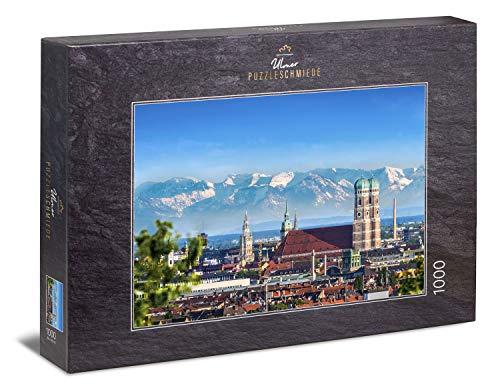 """Ulmer Puzzleschmiede - Puzzle """"Münchner Himmel"""" - das 1000 Teile Puzzle mit dem klassischen München-Motiv - Frauenkirche mit Alpen-Panorama am Horizont – der Blick über die Hauptstadt von Bayern"""
