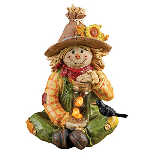 Solar Smiling Scarecrow Fall Garden Statue That's Holding a Clear Jar with a String of Lighted Pumpkins