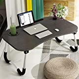 Large Bed Tray - The folding size of our laptop desk is 60(L) x 40(W) x 26cm(H). Multi-Functional Desk – This Bed Table Built-in iPad stand groove for holding ipad or kindle and desk comes with a table cup holder to store cups well. The Anti-Slip Spo...