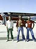 The Bee Gees in Front of an Airplane Photo Print (60,96 x