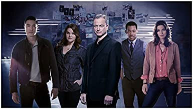 Criminal Minds: Beyond Borders (TV Series 2016 - ) 8 inch x10 inch Photo Gary Sinise & Cast in Front of Wall of Pics kn