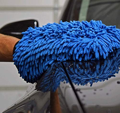 Blue microfiber chenille wash mitt wiping side of vehicle.