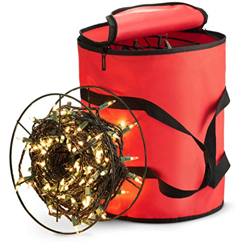 red circle bag with a reel with lights wound up on it leaning against the bag