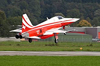 An F-5E Tiger of the Patrouille de Suisse demo team taking off Poster Print by Timm ZiegenthalerStocktrek Images (17 x 11)