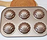 moule à 6 madeleines en acier carbone anti-adhésif formes coquillages et bananes banane