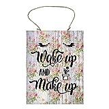 Letrero de madera con texto en inglés 'Wake Up and Make Up'