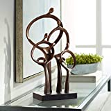 """19 1/4"""" high x 11"""" wide x 5 1/4"""" wide. Weighs 4.7 lbs. Abstract modern sculpture depicts a family standing holding hands. A modern home sculpture accent from the Kensington Hill brand. Lightweight cast resin construction. Bronze finish. Black finish ..."""