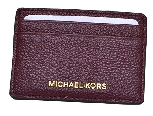 "A gleaming logo detail heighten the upscale appeal of this compact card holder from MICHAEL Michael Kors. 3-7/8""W x 2-3/4""H Open closure Gold-tone exterior hardware, logo & 4 credit card slots MK coated twill faux leather; lining: polyester Imported ..."
