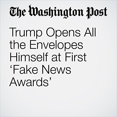 Trump Opens All the Envelopes Himself at First 'Fake News Awards' copertina
